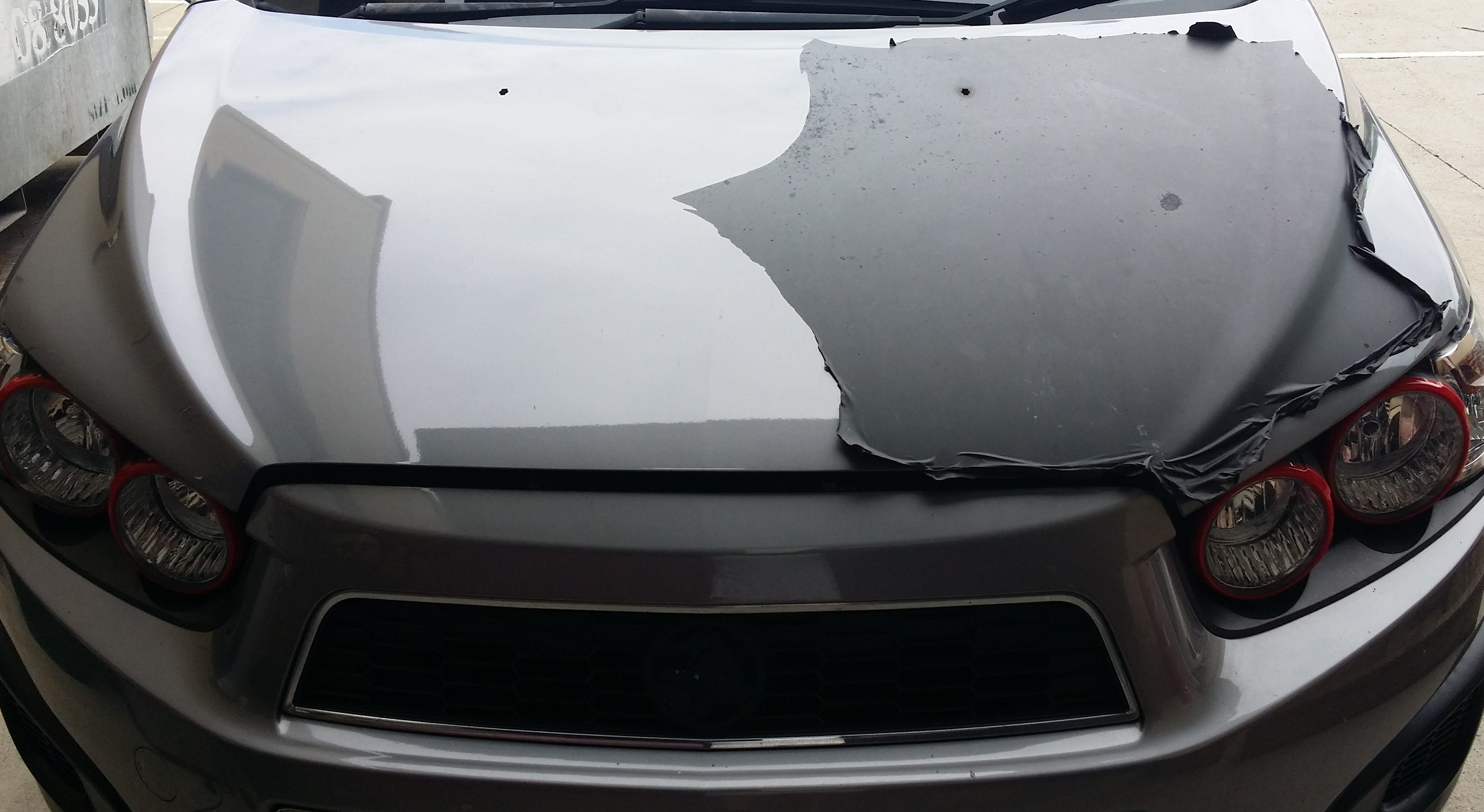 From the previous owner this matt black car bonnet wrap is tired and old time to remove it